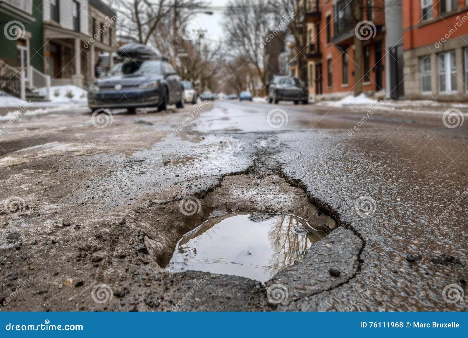 Large deep pothole