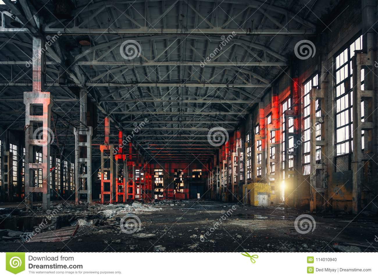 Large empty abandoned warehouse building or factory workshop, abstract ruins background