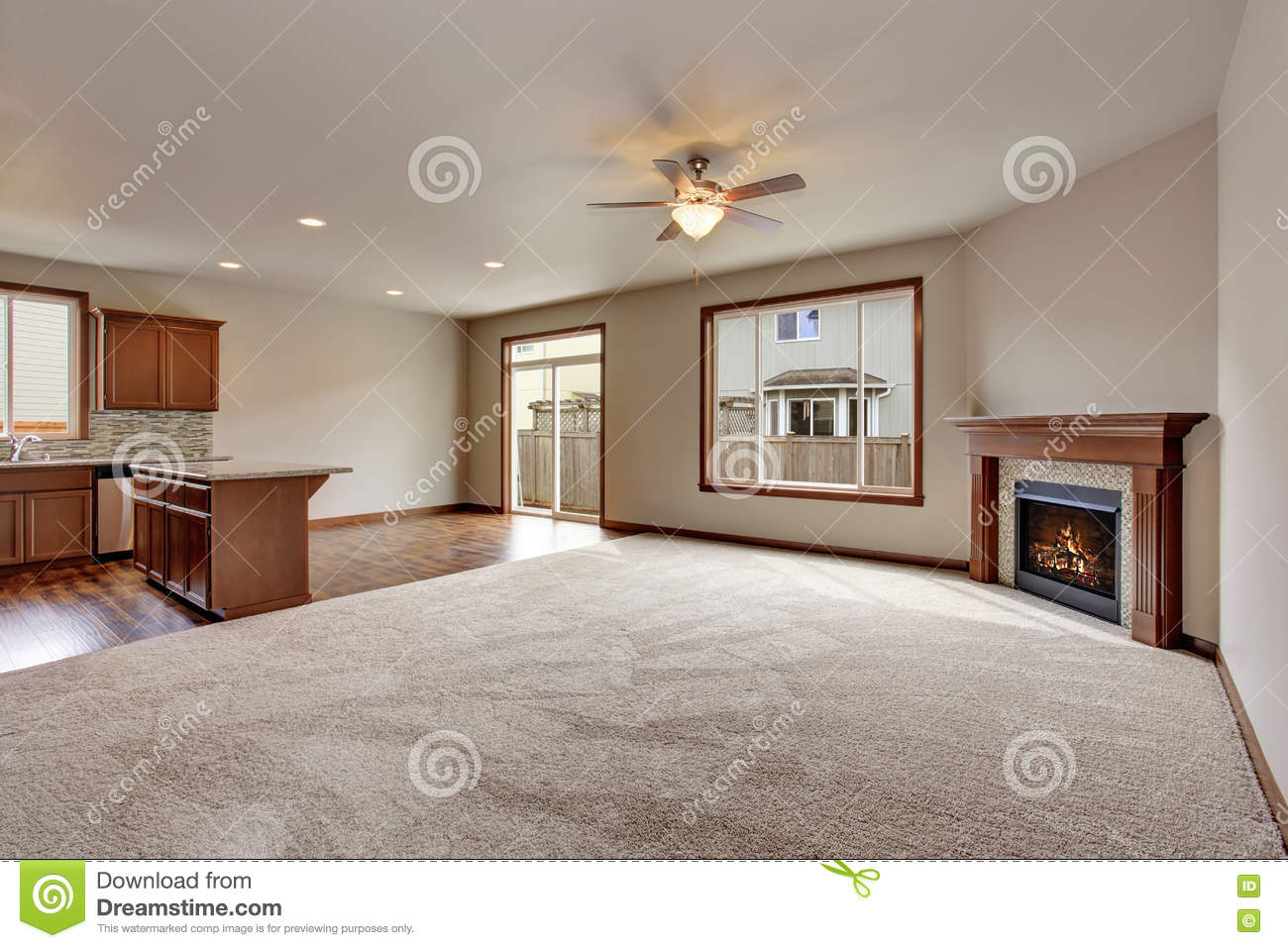 large empty living room interior with carpet floor and