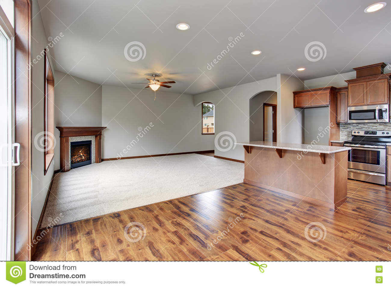 large empty living room interior connected with kitchen
