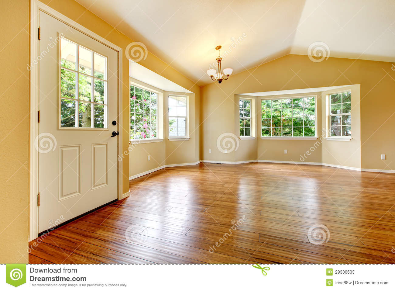 Large empty newly remodeled living room with wood floor for Big empty living rooms