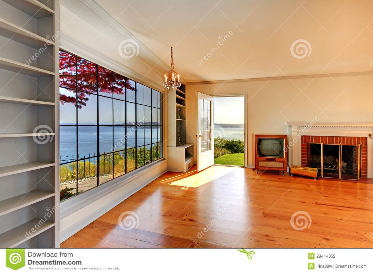 Large empty old living room interior with fireplace stock for Big empty living rooms