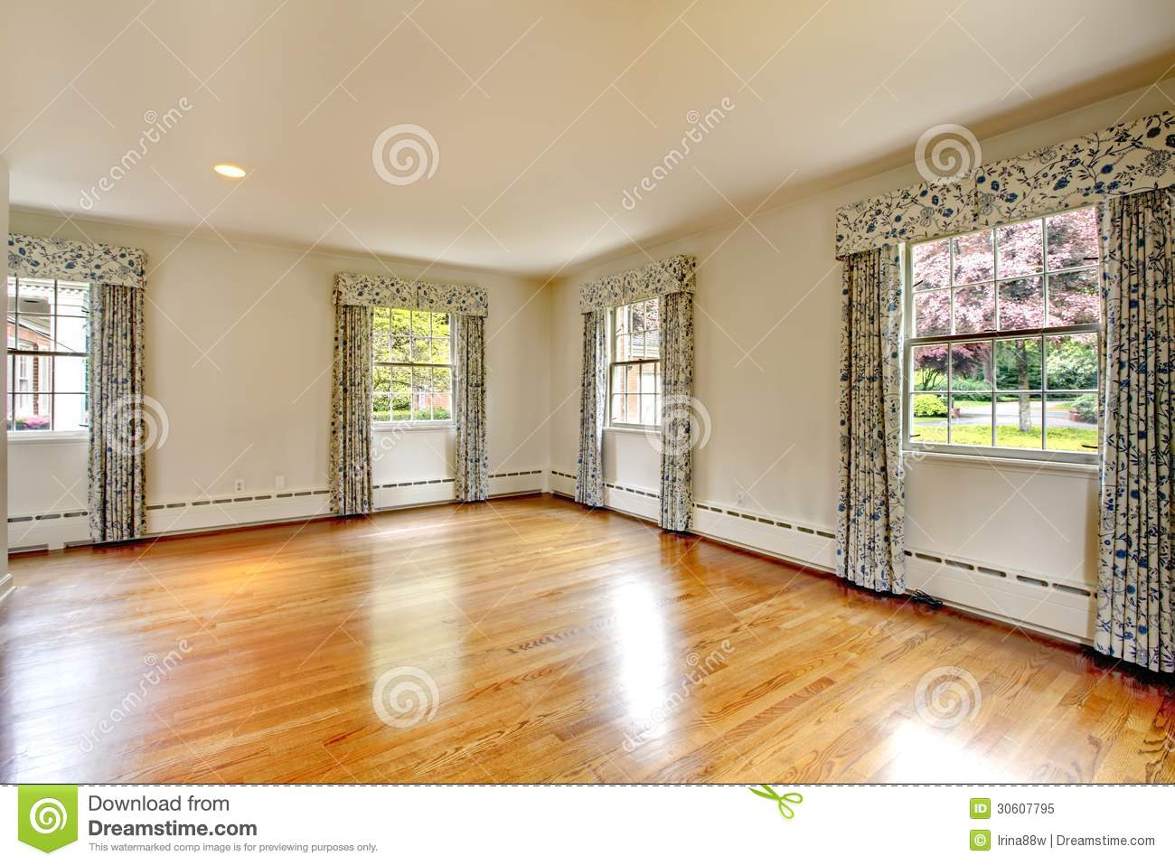 Large empty room with hardwood floor and curtains old luxury home stock image image 30607795 for Pictures of bedrooms with hardwood floors