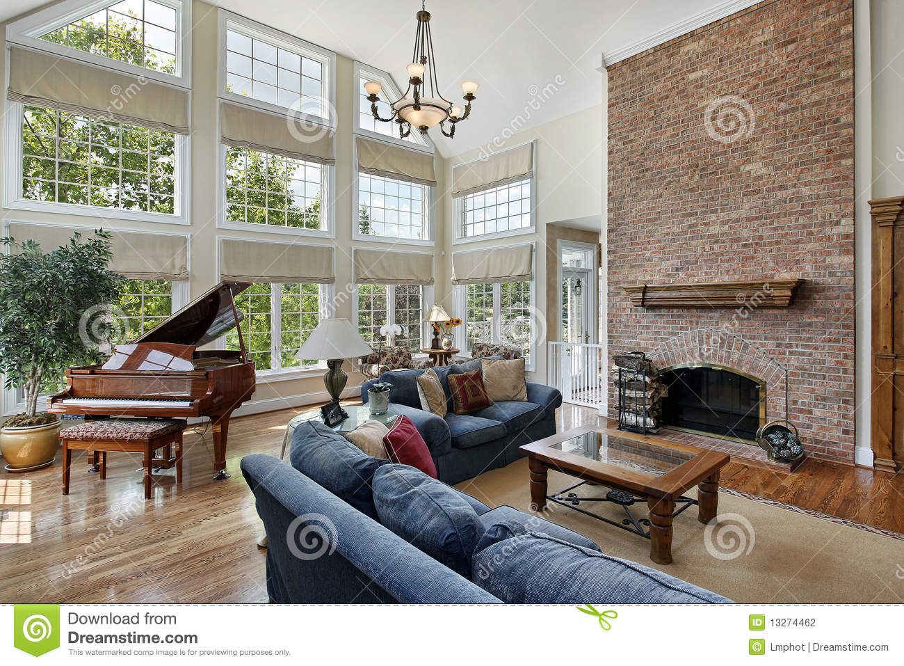 Large family room with two story windows stock photo for Large family living room