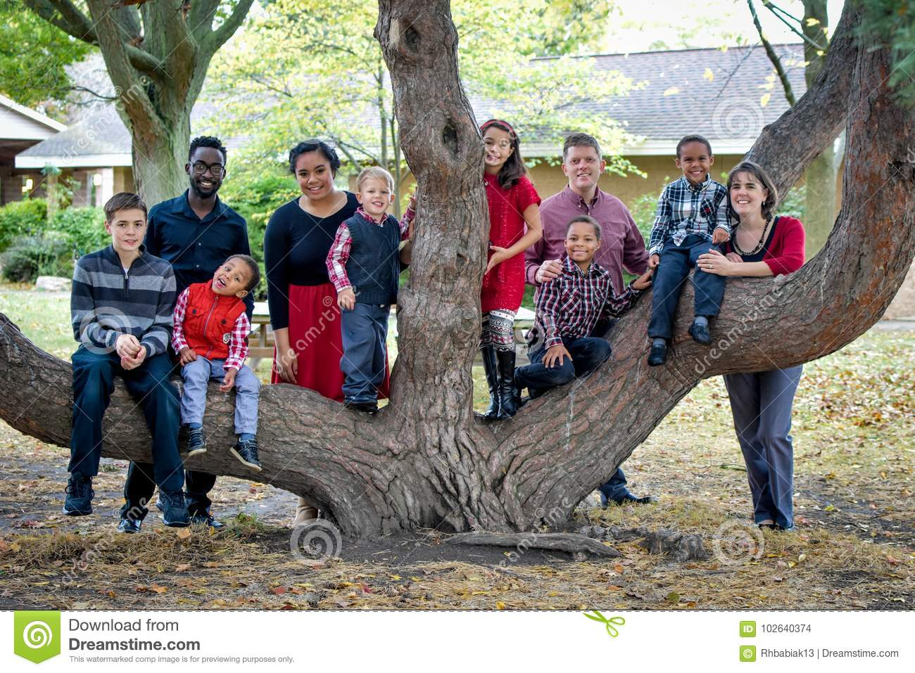 Large Family by Tree