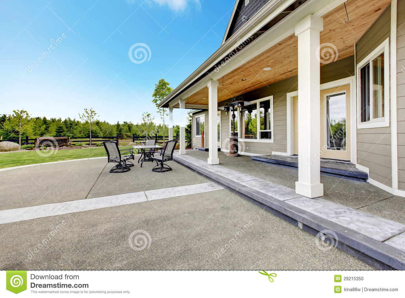 Large Farm Country House With Long Covered Porch Stock