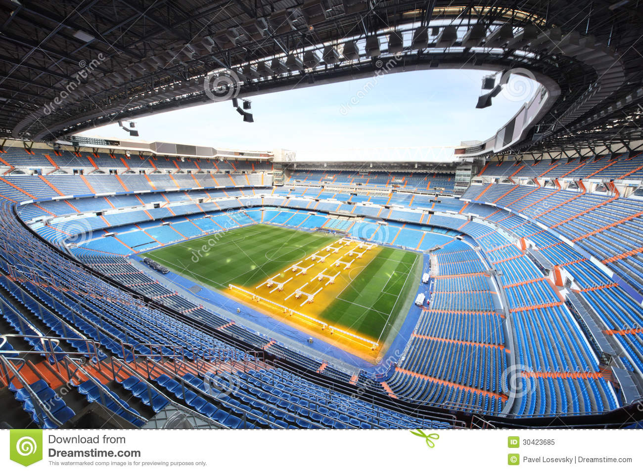 Large football stadium with grandstand and artificial light