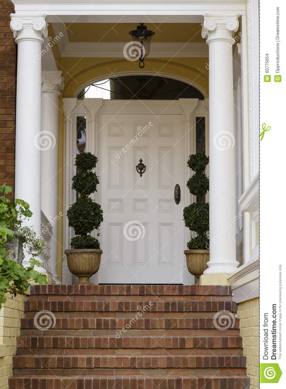 Large front door with white exterior with brick steps for Large front door