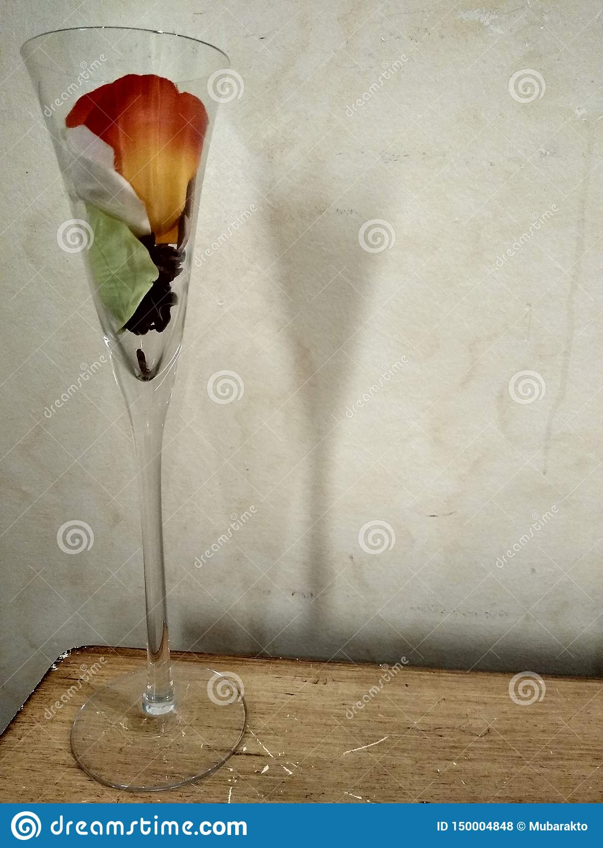 Large glass with flower in