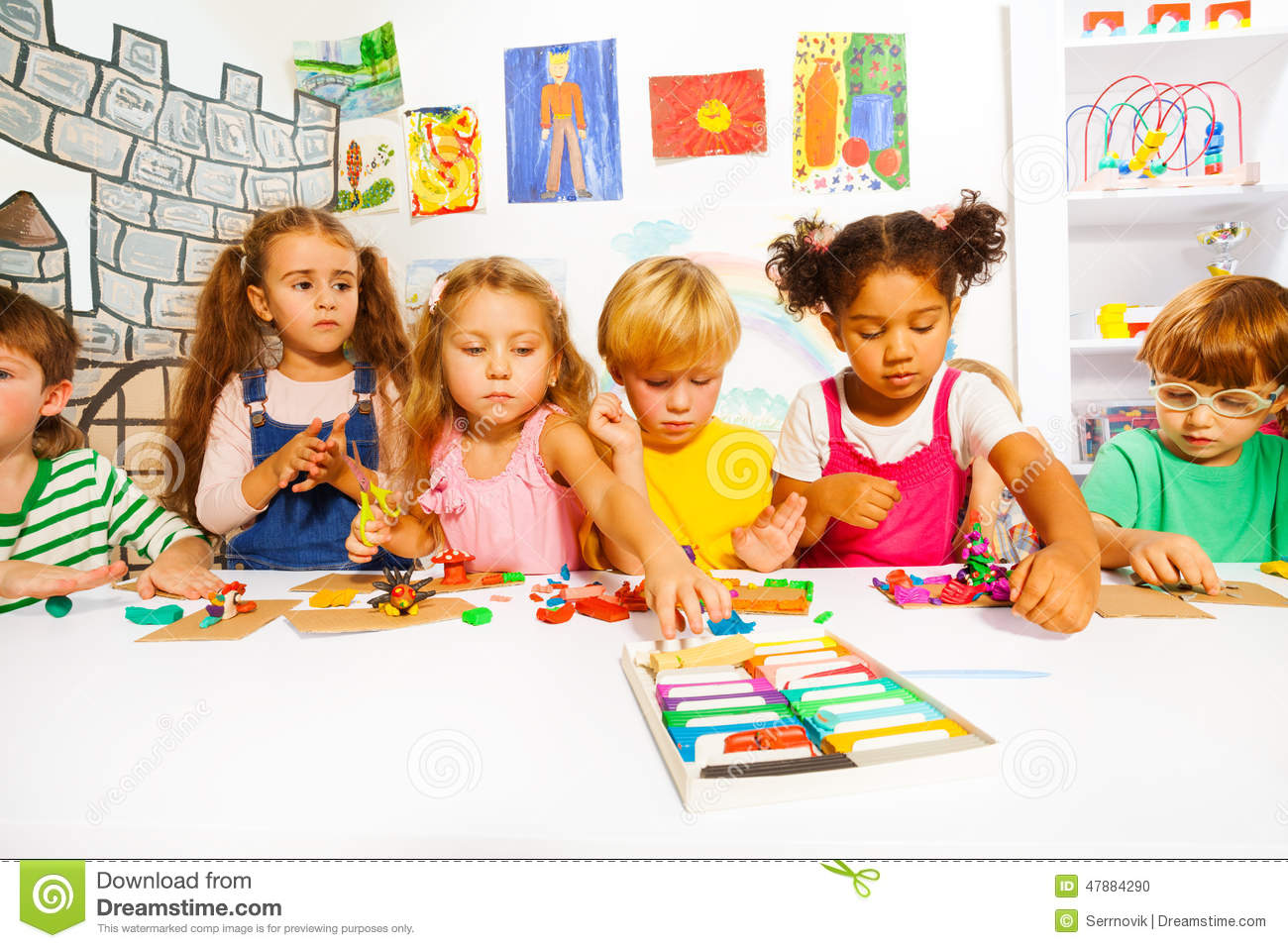 Kinder Garden: Large Group Of Kids Play With Modeling Clay Stock Photo