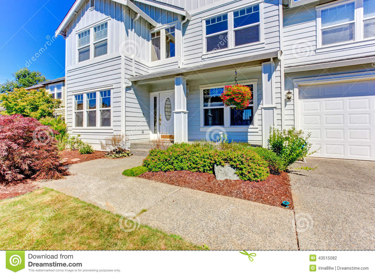 Large house exterior driveway and front yard view stock for Entrance from garage to house