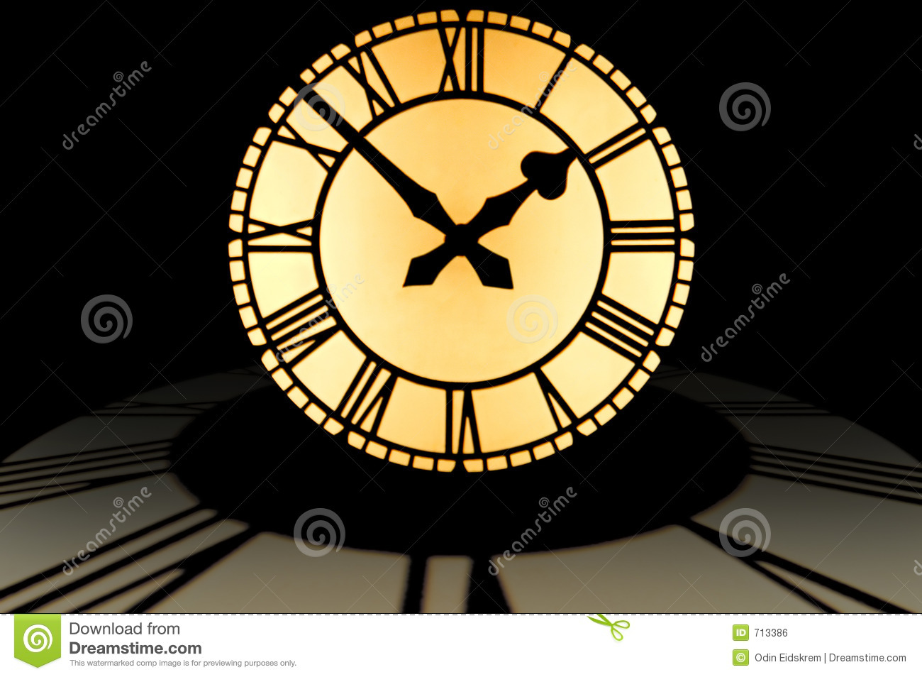 Large Illuminated Clock Dial At Ten To Two On Top Of A