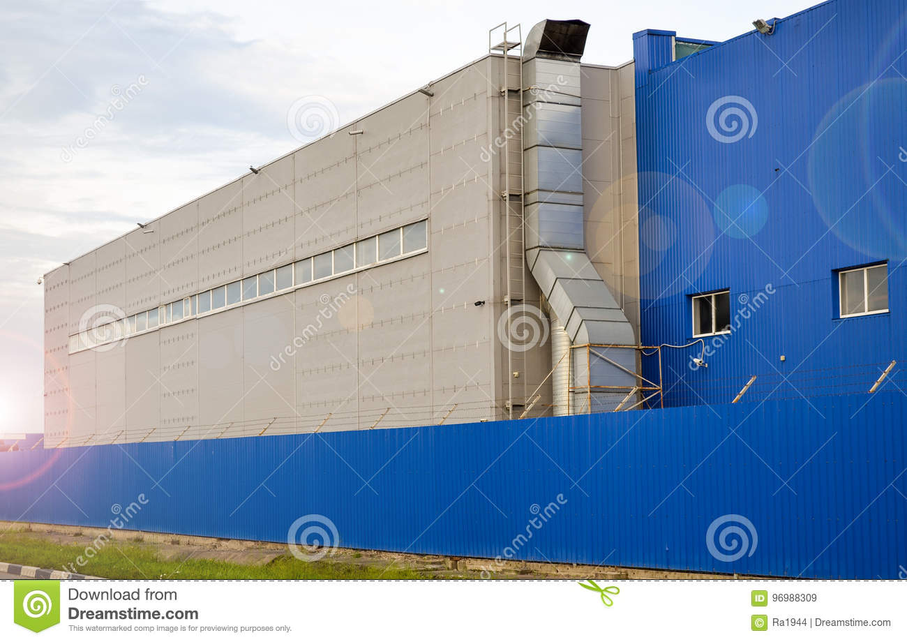 Large industrial building of blue color