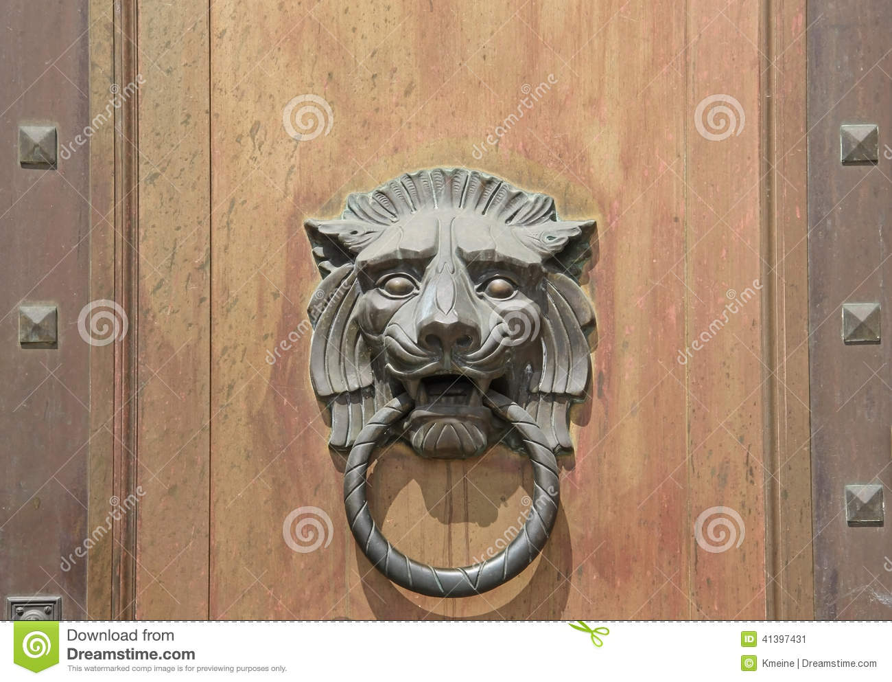 Large Lion Head Door Knocker On Wood Door Background Stock