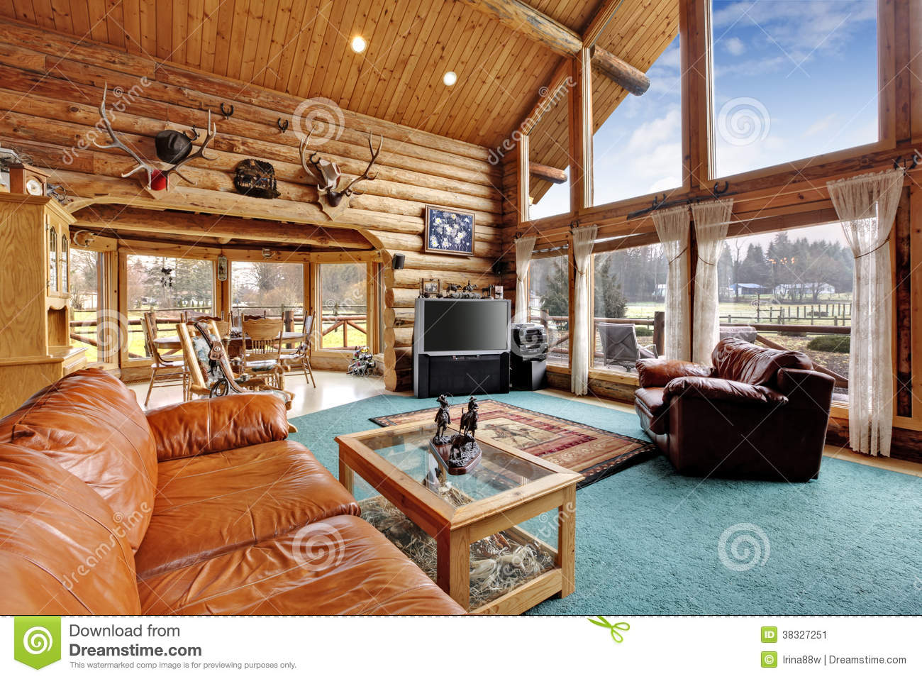 Large Living Room With Diining Area In Log Cabin House Stock