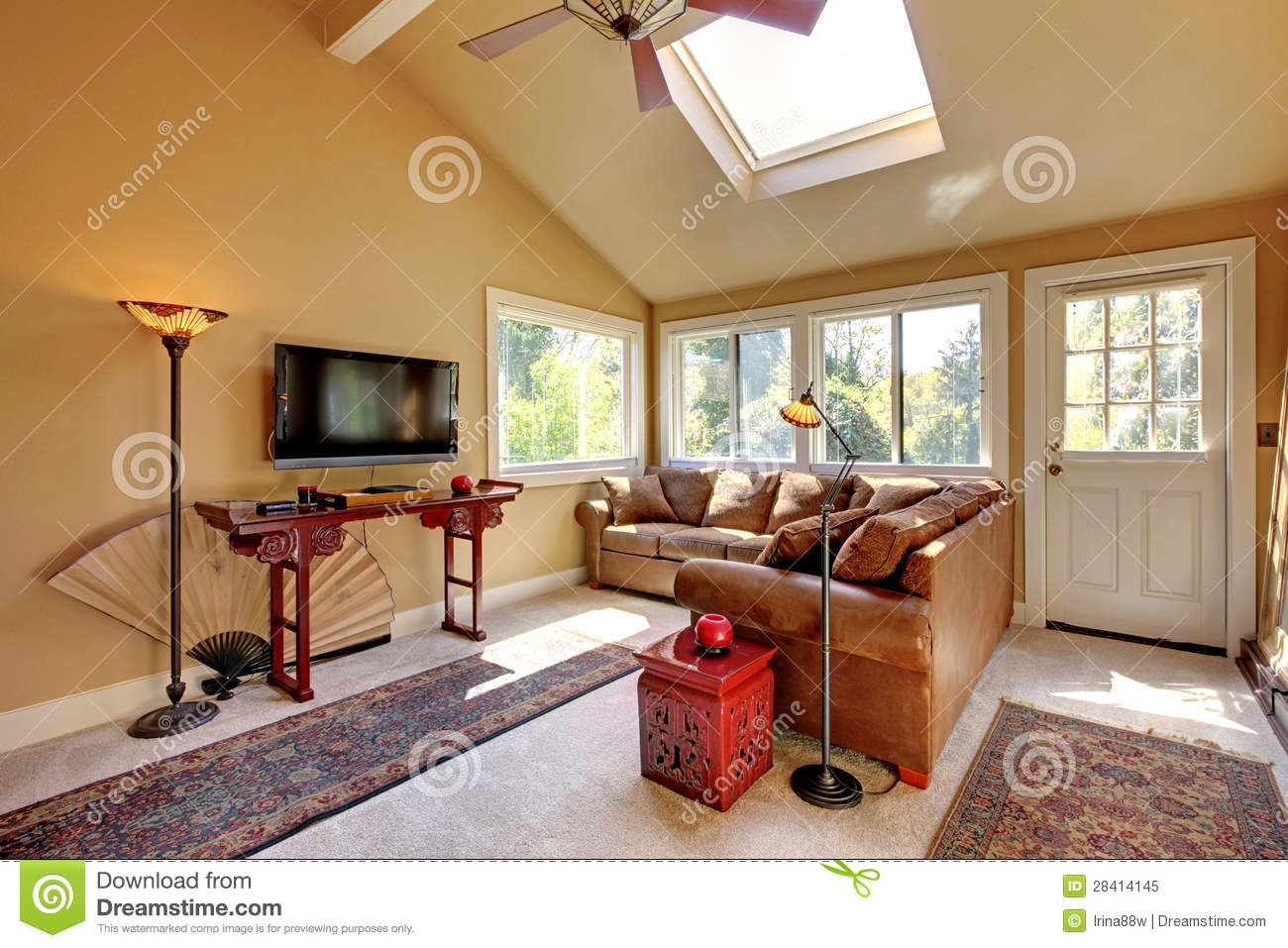 Large Living Room With Sofa Tv And Brown Walls Royalty