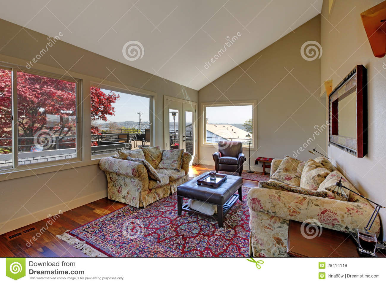 Large living room with two sofas and red rug royalty free for Large living room sofas