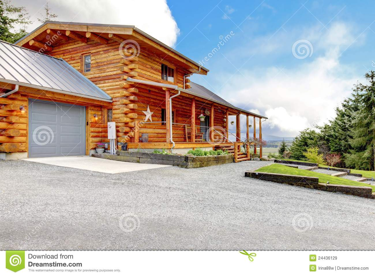 Large log cabin with porch and garage stock image image for Garage cabins