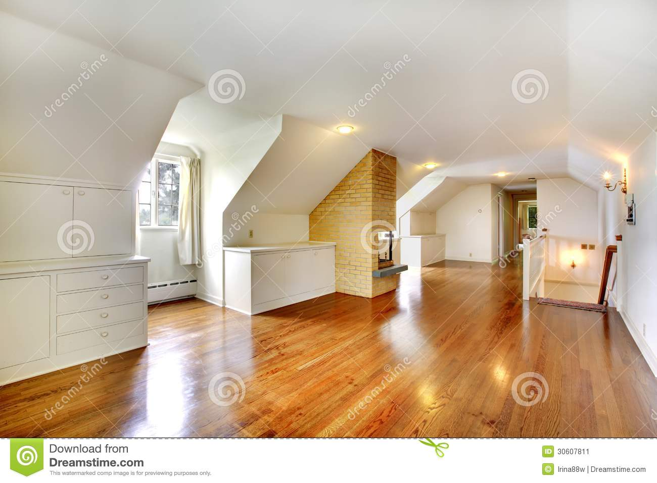 Large Long Attic Room With Fireplace Empty With Golden