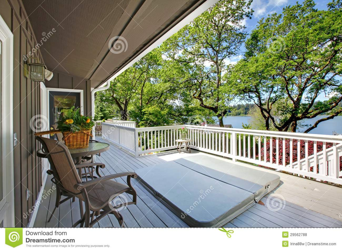 Large long balcony home exterior with hot tub and chairs for Balcony hot tub