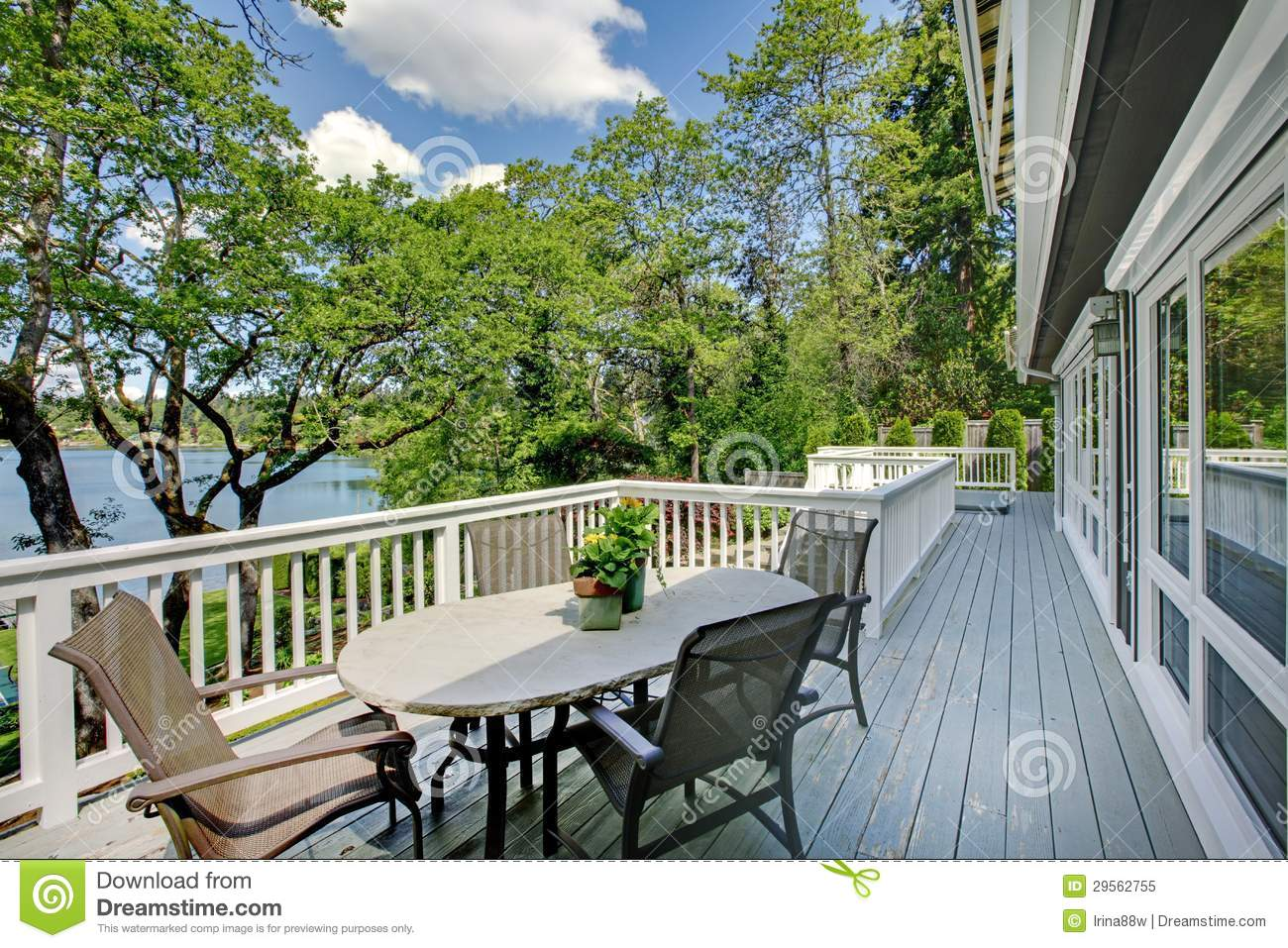 Large long balcony home exterior with table and chairs for Balcony with view