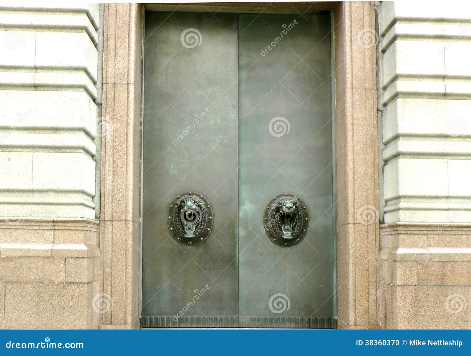 Big Metal Door : Large metal doors with lion handles stock photo image of