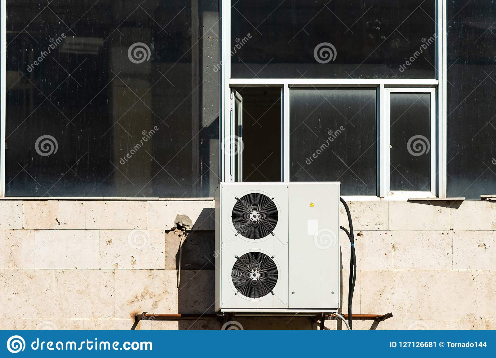 Open Window Over The Air Conditioner Outdoor Unit Stock