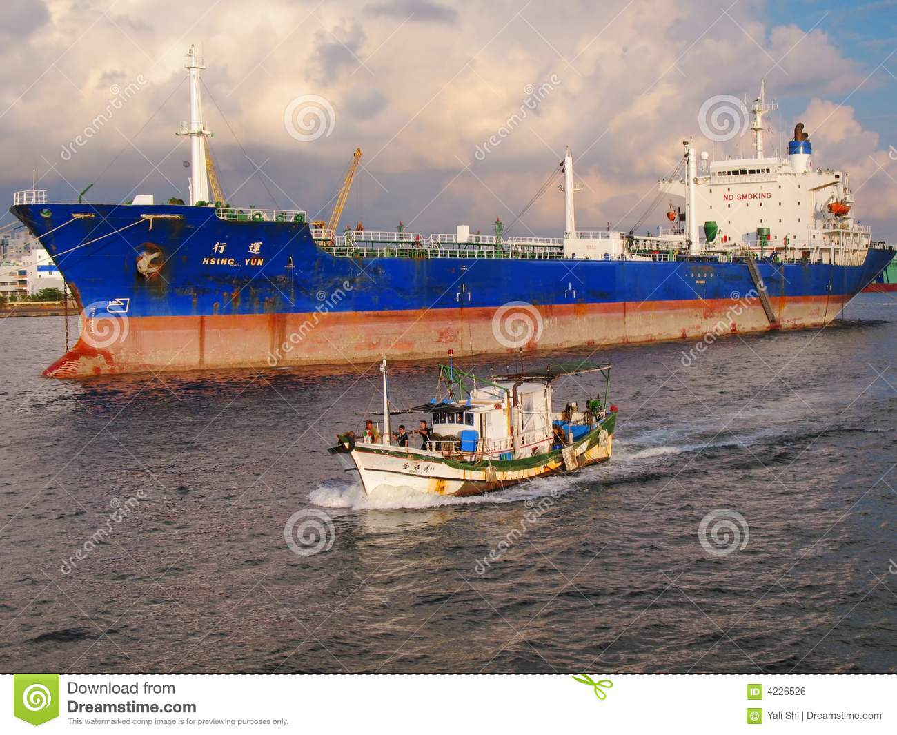 Large Oiltanker and Chinese Fishing Boat