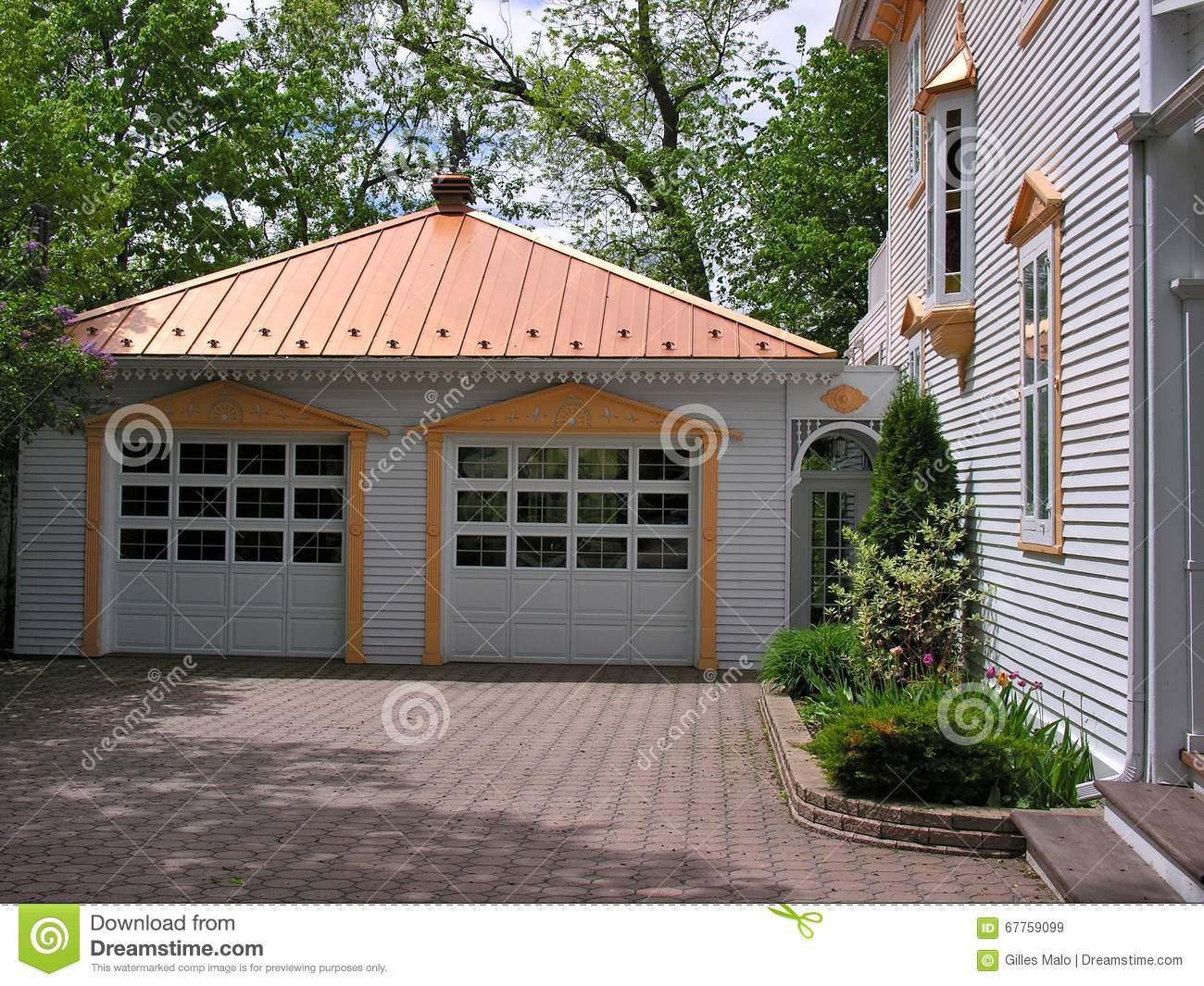 Large old house with garages in small town canada stock for Homes with huge garages