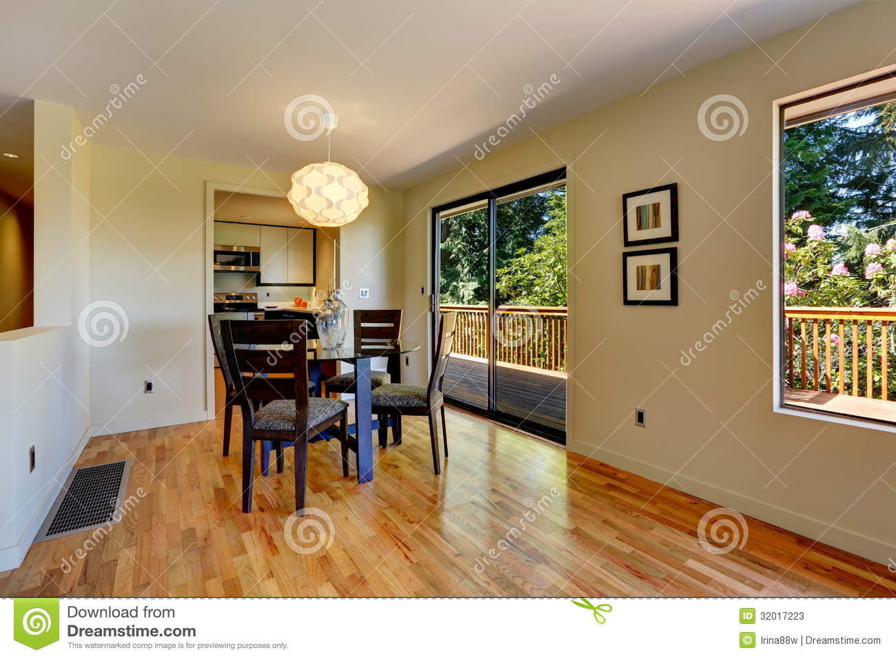 Large Open Space With Dining Room Table And Balcony Door