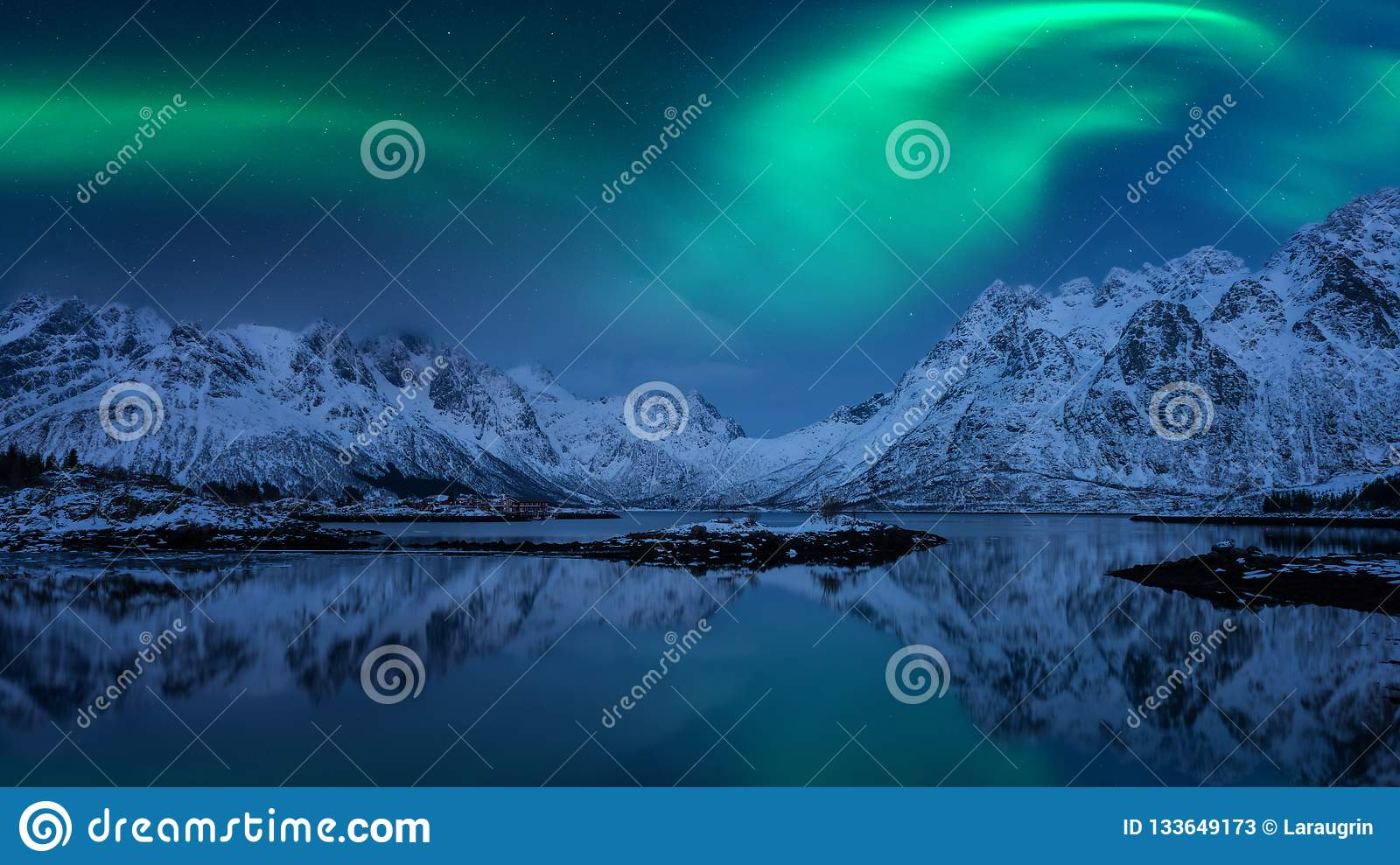 Northern lights, Aurora borealis, Lofoten islands, Norway. Night winter landscape with polar lights, starry sky and mountains