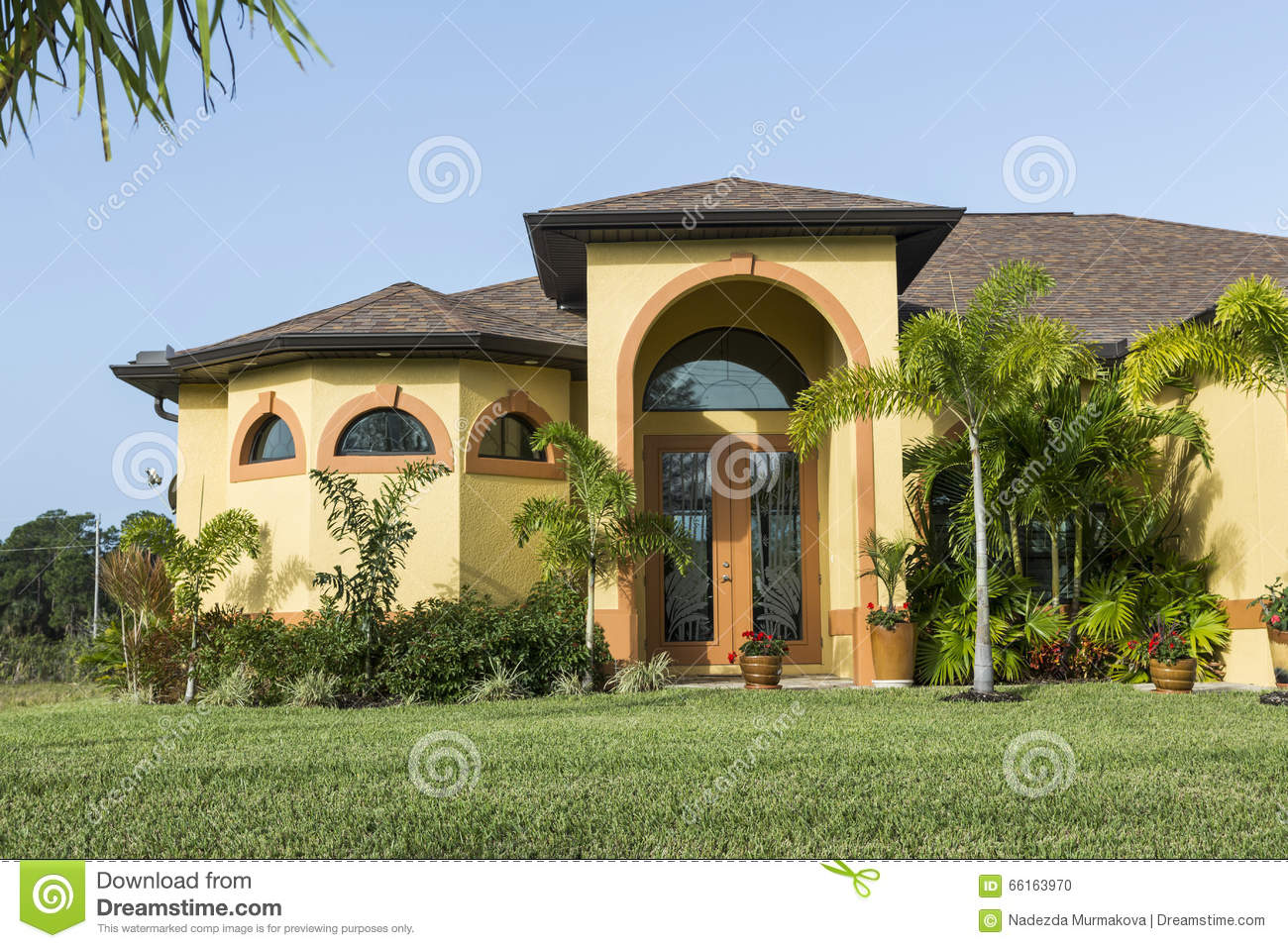 Large pink and yellow tropical house with circular for Concrete homes florida