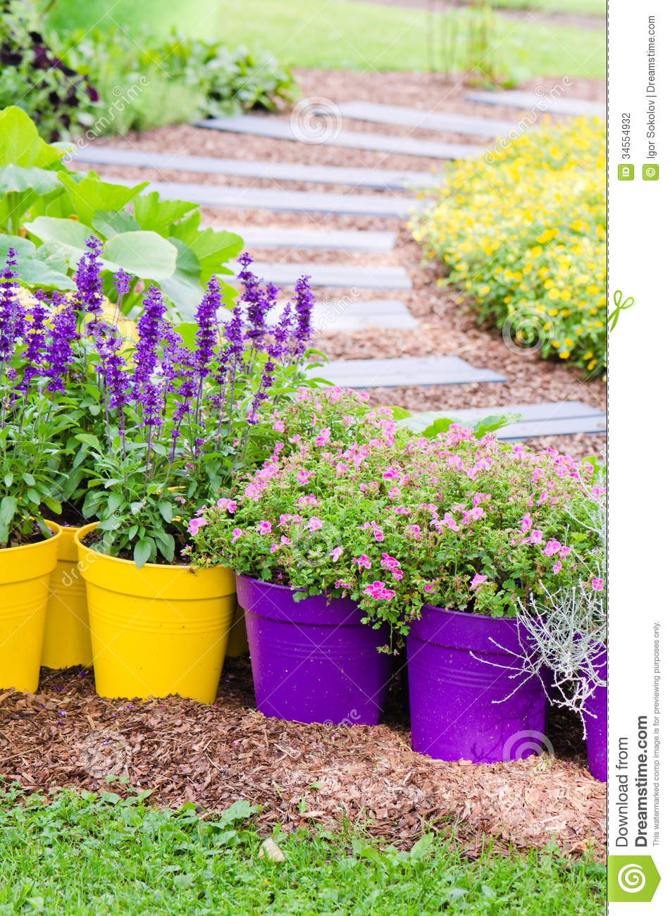 Huge Flower Garden : Large plant pots with flowers in the garden stock photo