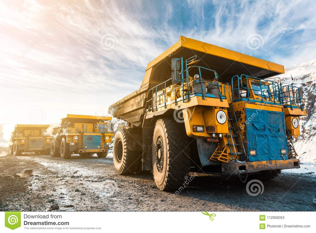 Large quarry dump truck. Loading the rock in dumper. Loading coal into body truck. Production useful minerals. Mining