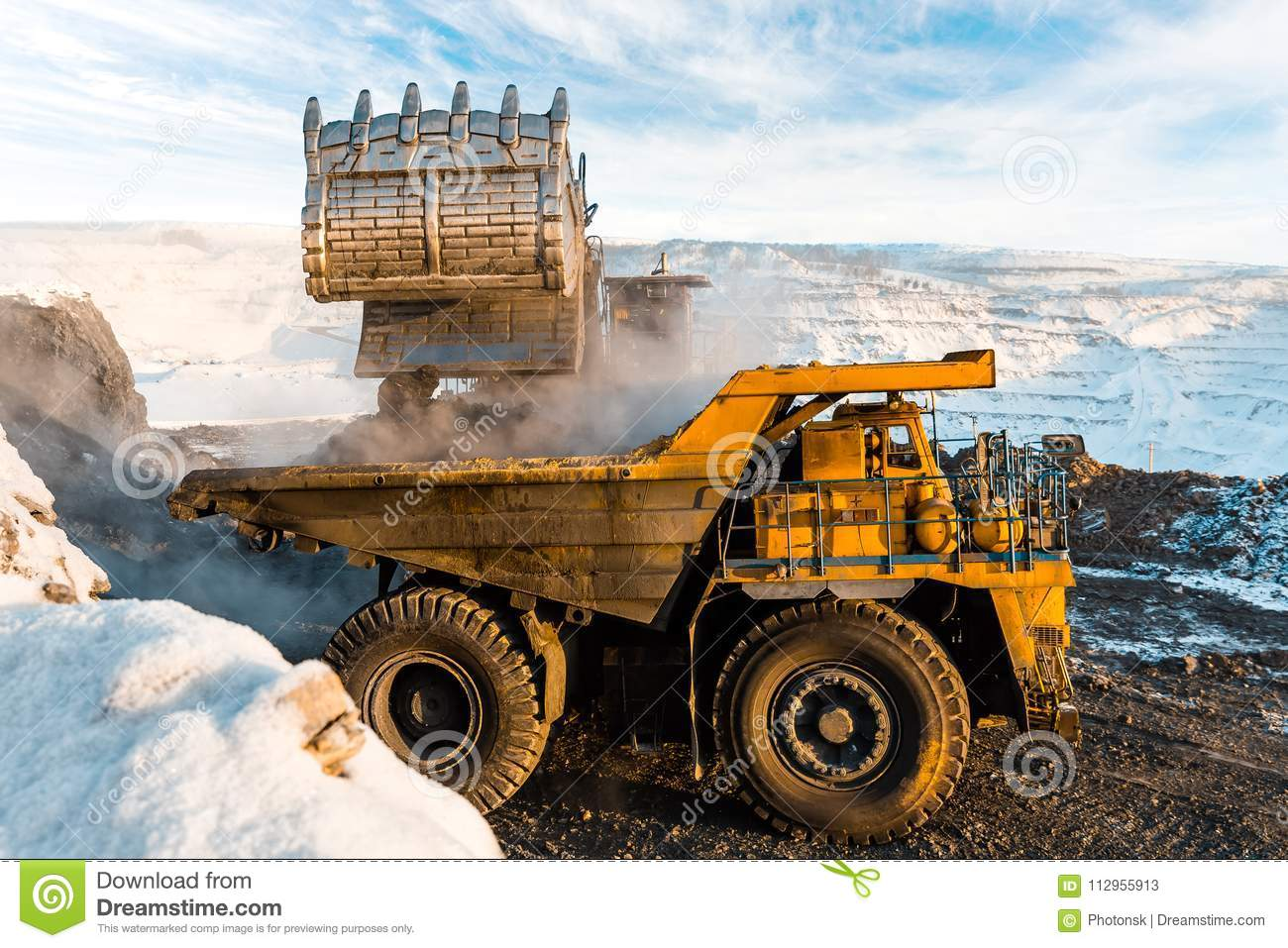 Large Quarry Dump Truck  Loading The Rock In Dumper  Loading