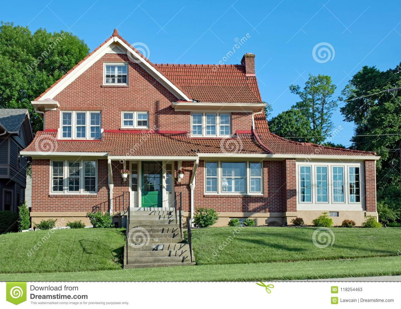 Large red brick house with red tile roof