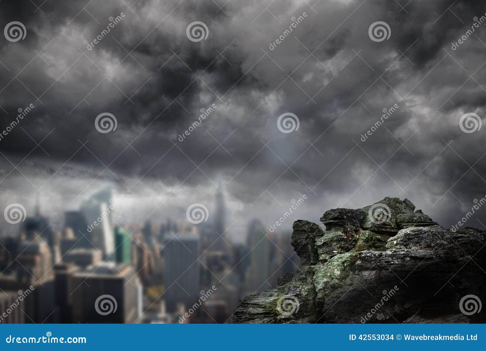 Large rock overlooking dark city