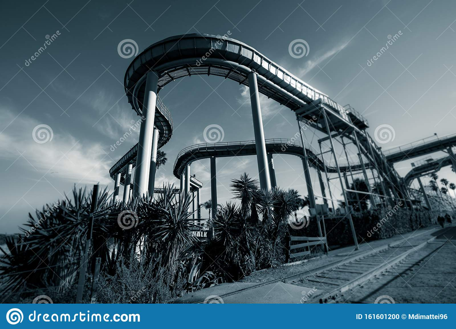 Scary Abandoned Amusement Park With Roller Coaster Tracks Largely In The Foreground Stock Photo Image Of Abandoned Weird 161601200