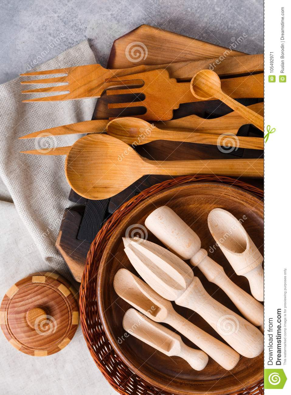 A large set of different kitchen devices are made of wood view from above