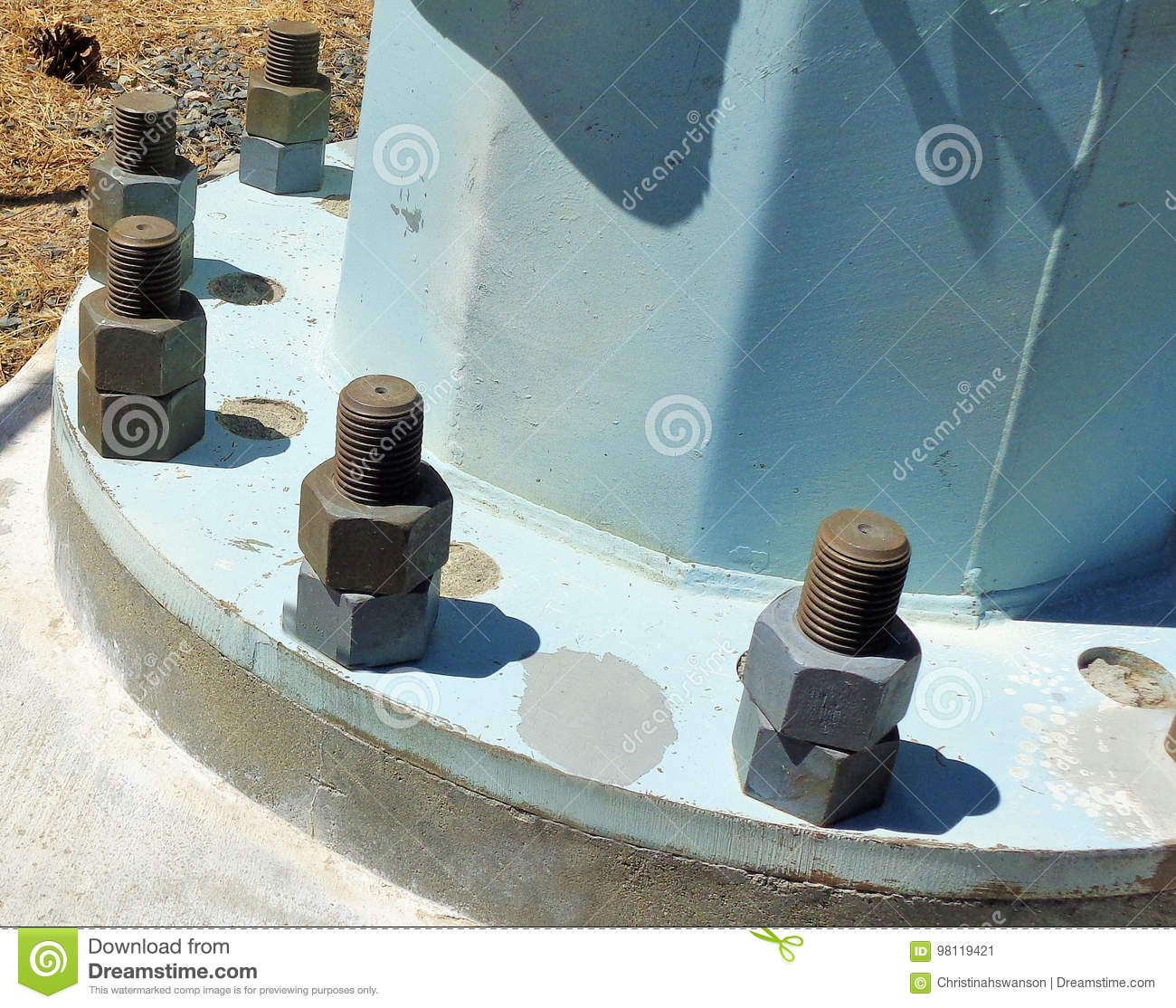 Large Size Nuts And Bolts At The Base Of A Pillar Stock