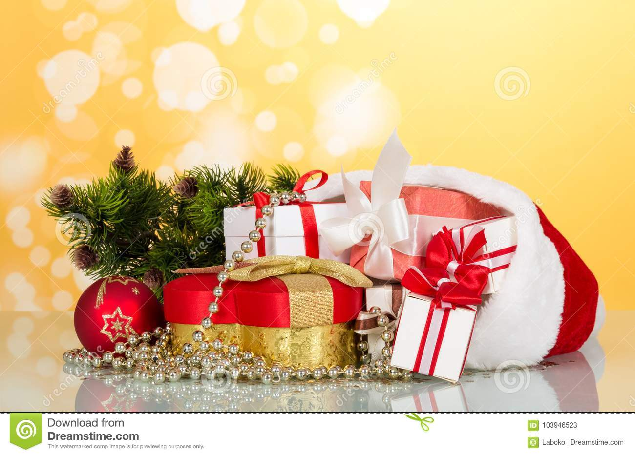 large and small boxes in the header of santa claus next to gift in heart shaped decorations for the christmas tree on bright yellow background - Christmas Decorations Large Santa Claus