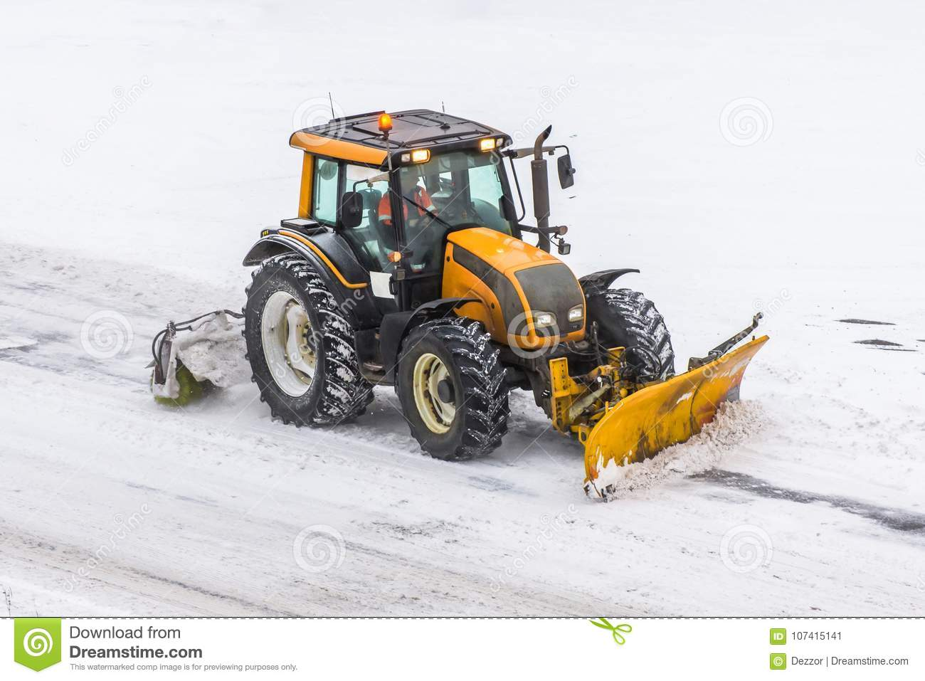 Large Snow Plowing Tractor Machine At Work On The Road