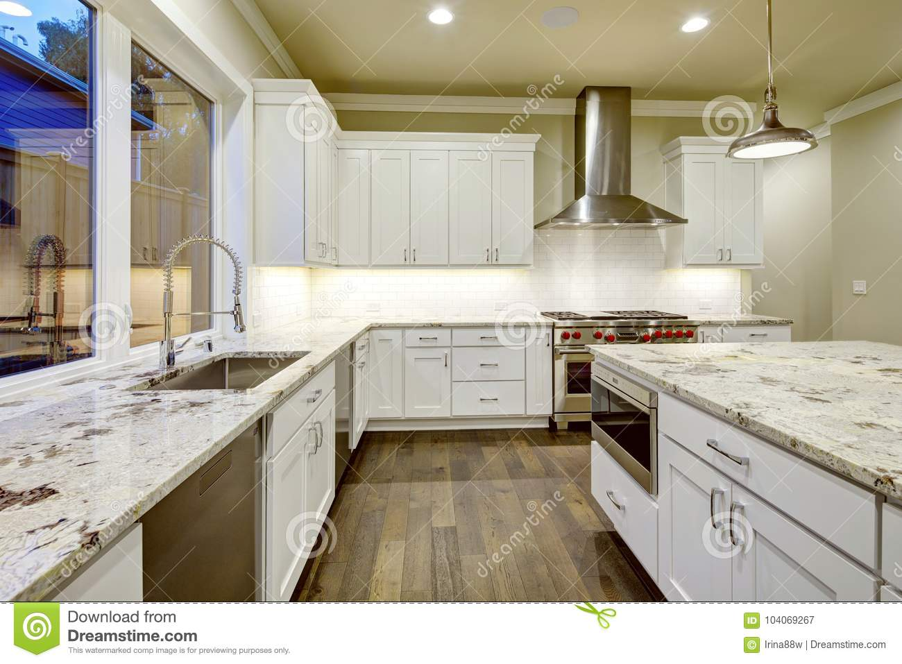 Large, Spacious Kitchen Design With White Kitchen Cabinets Stock ...