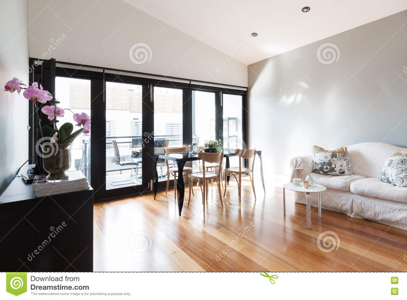 Studio Apartment Living large studio apartment living room with bi fold doors stock photo