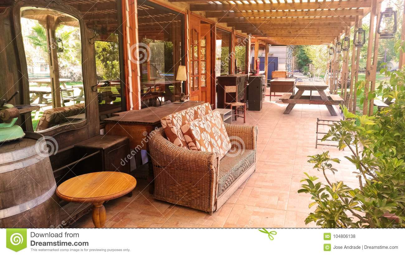 Large Terrace With Antique Wooden Furniture Stock Photo