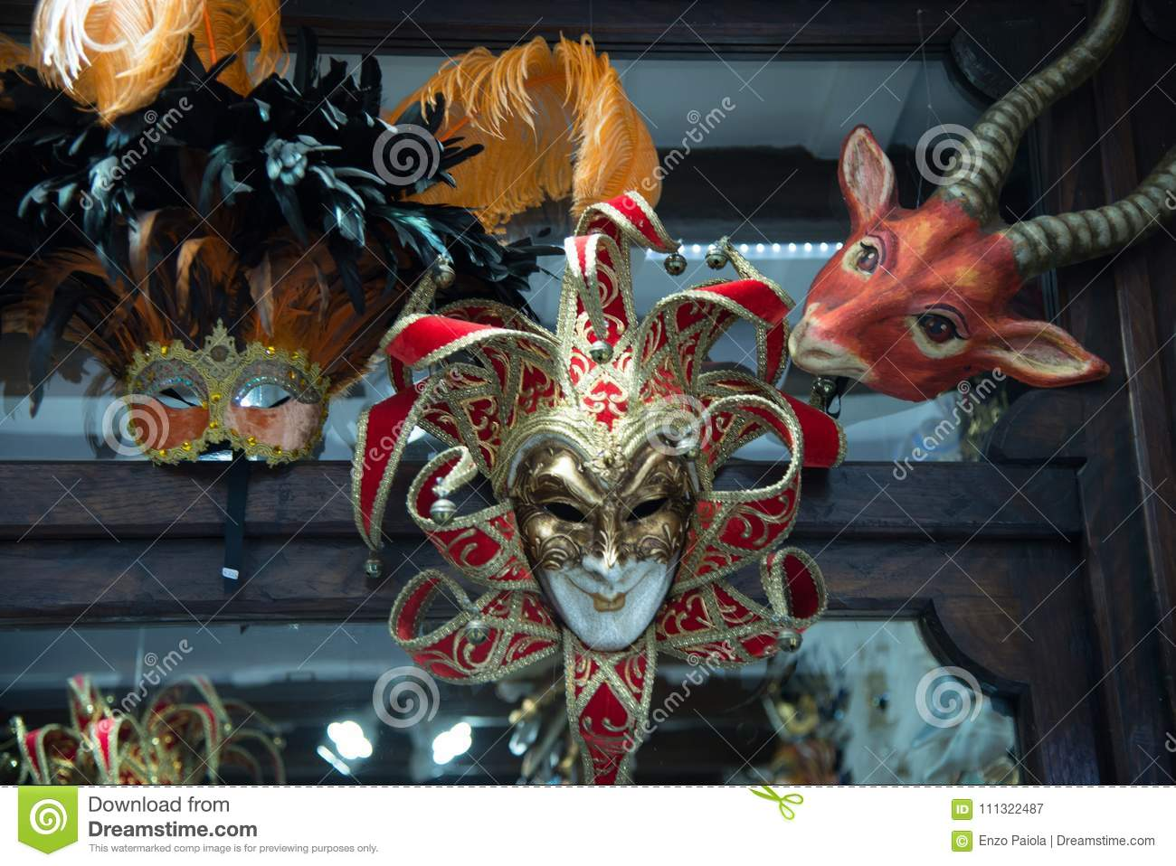 Traditional venetian mask in store on street, Italy