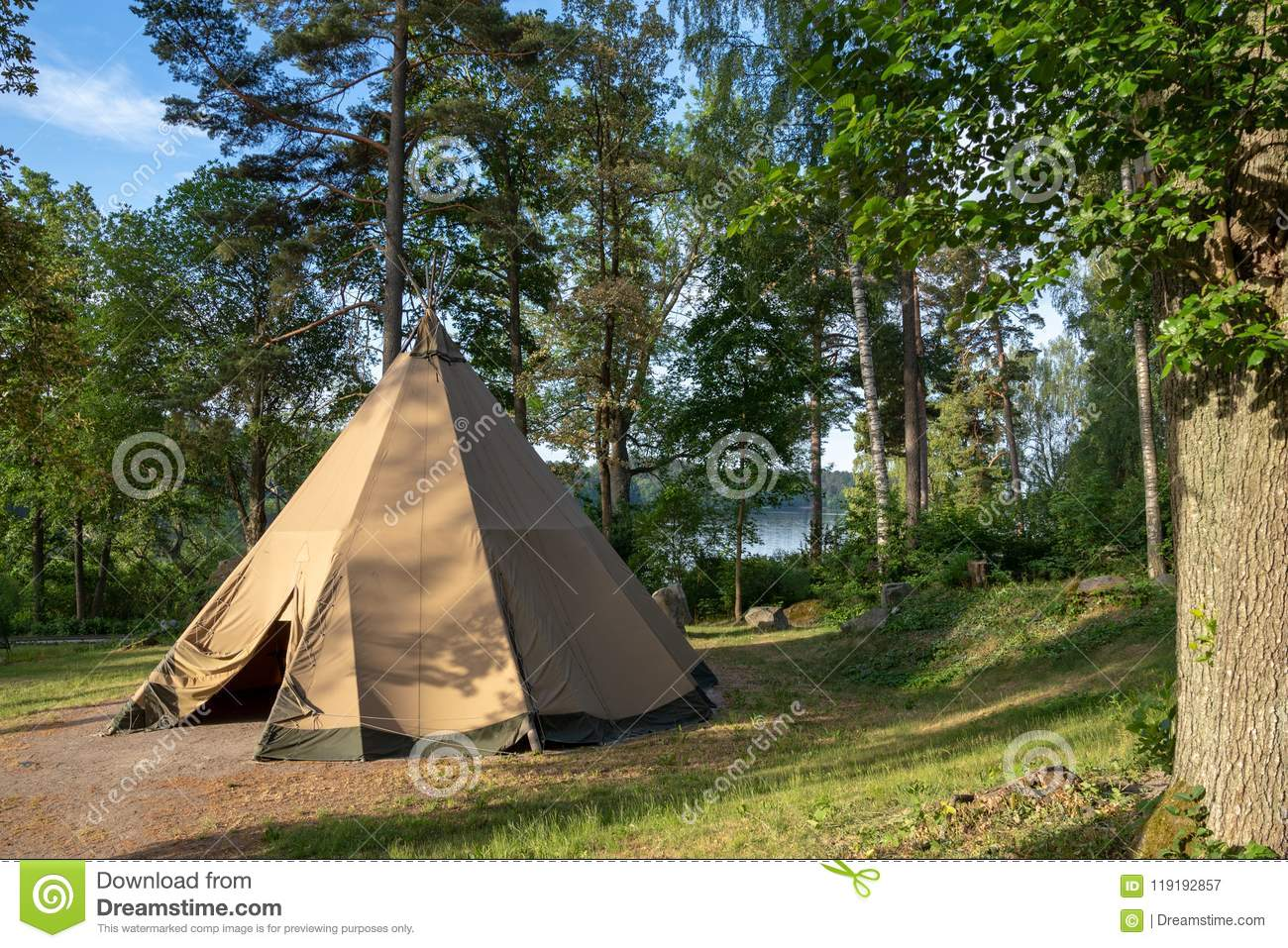 A large traditional teepee tent with luxurious glamping interior provides alternate but comfortable lodging for outdoor adventurer