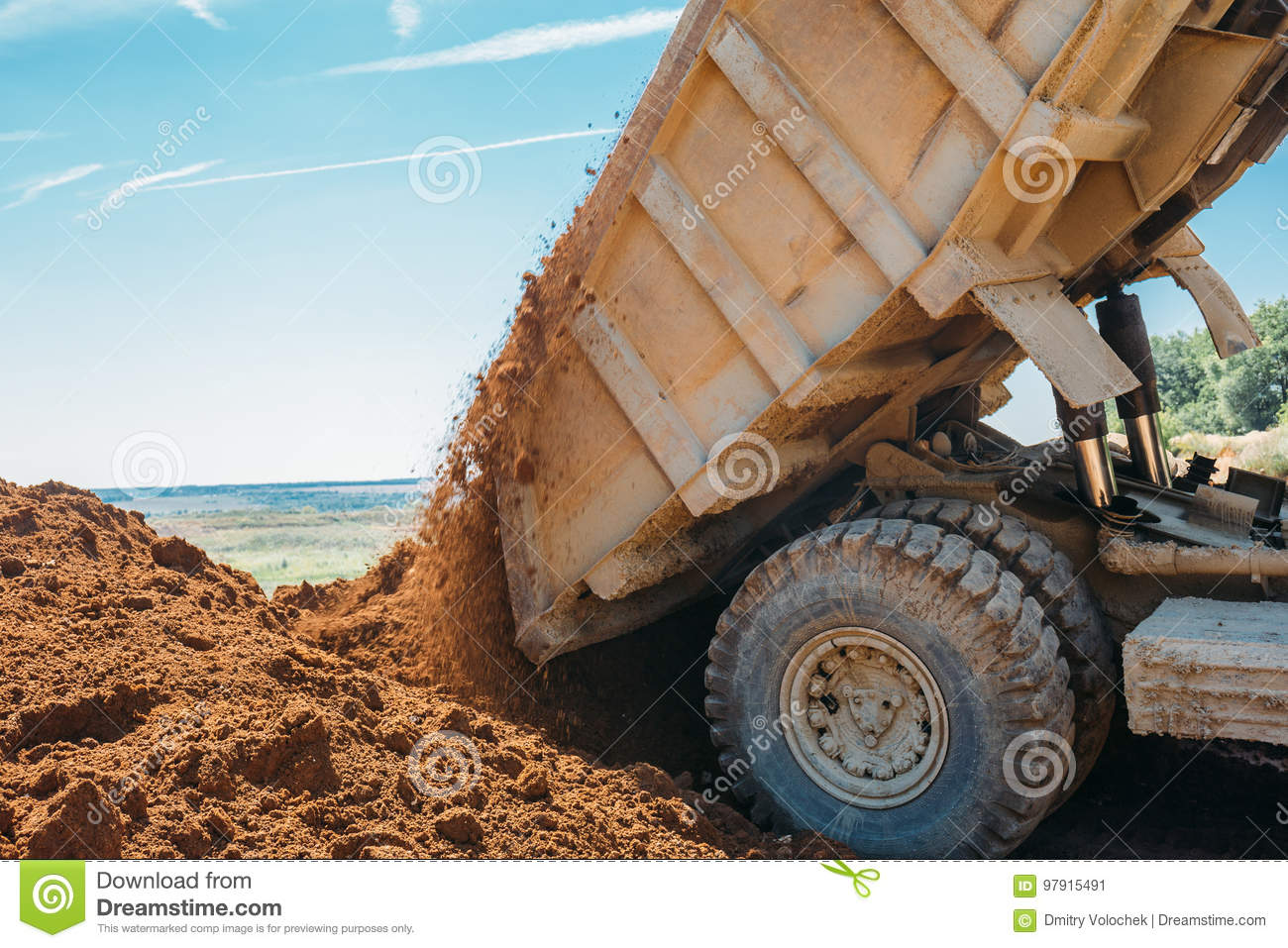 Large truck unloads clay and crushed stone