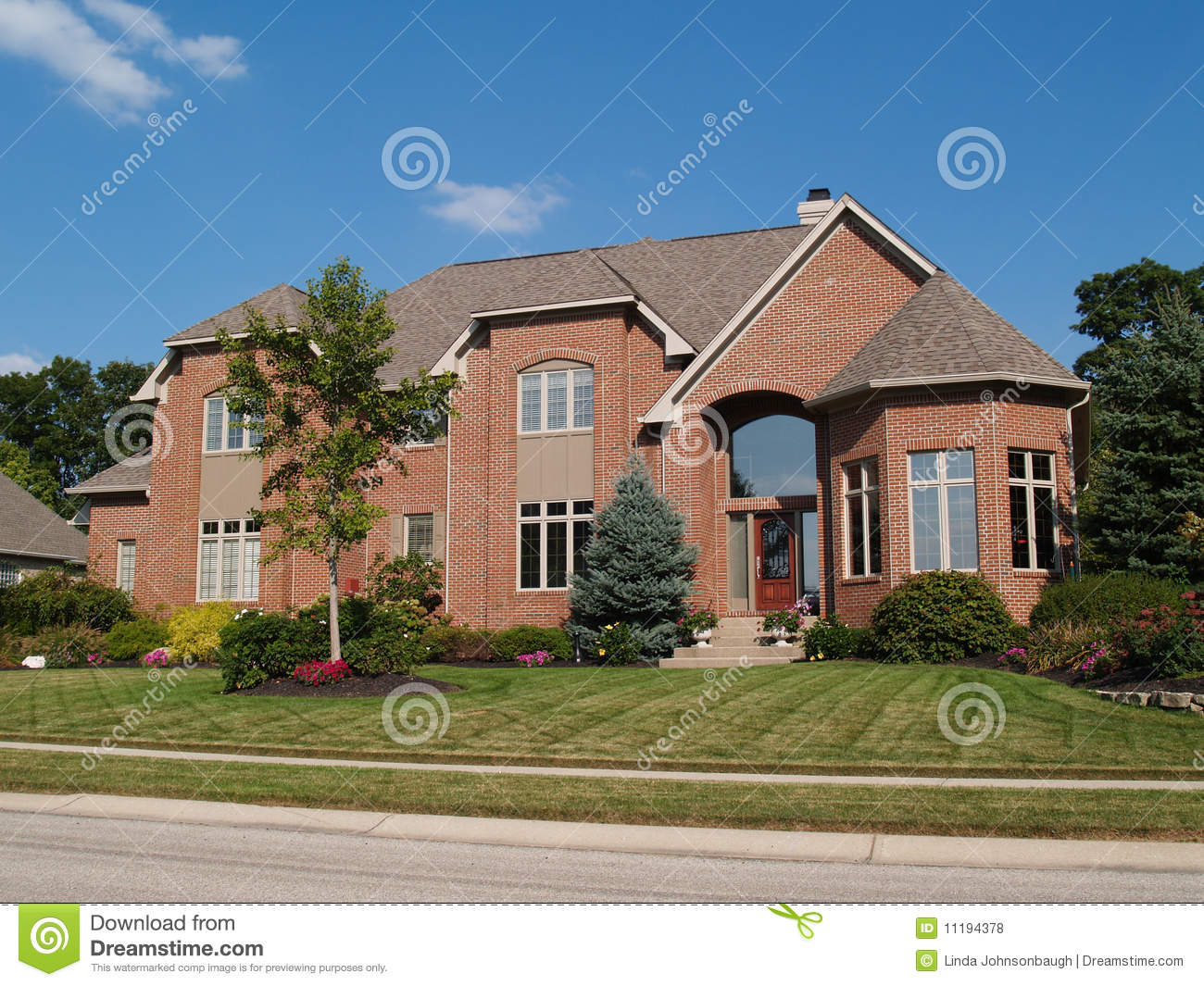 Large Two Story New Brick Home With Turret Stock Photo