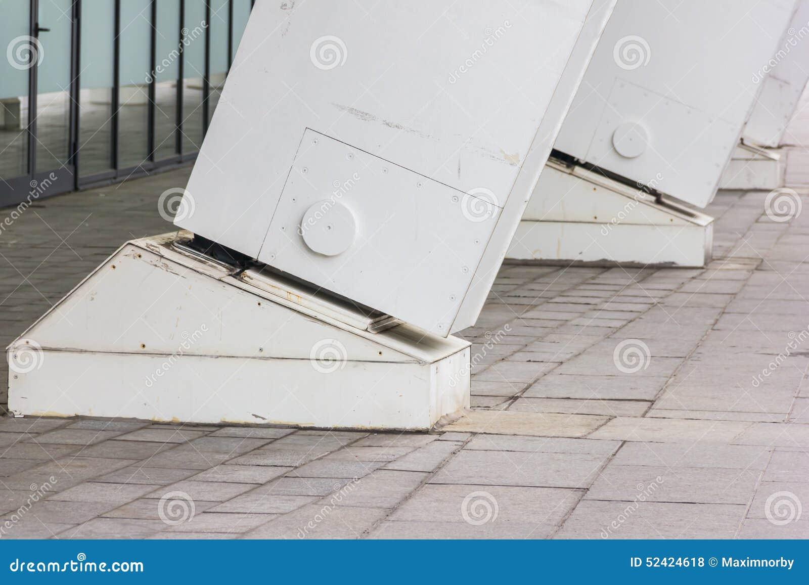 White Metal Pillars : Large white metal columns stock photo image